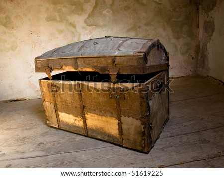 Very old chest like a treasure box in some grunge interior.
