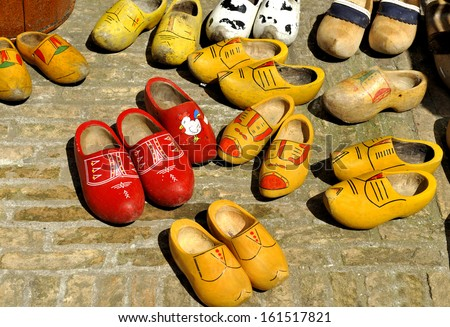Very old Colored Dutch wooden shoes - clogs at a flea market