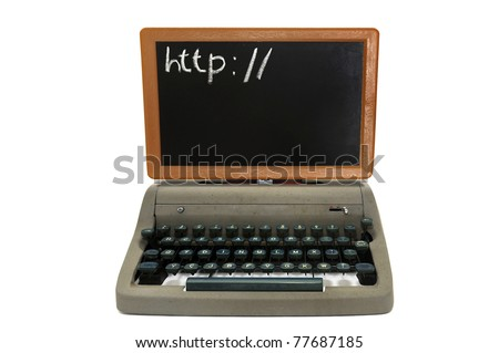 Very old fashion laptop isolated in white