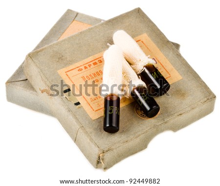 Very old 1940 iodine capsules under the white background