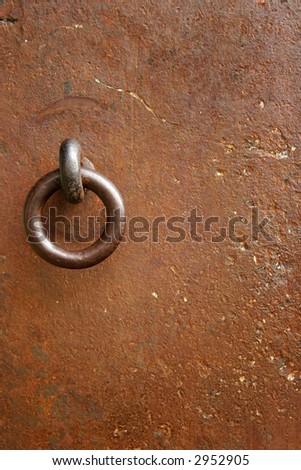 Very old iron door with rusty details