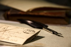 Very old letter and a feather quill pen