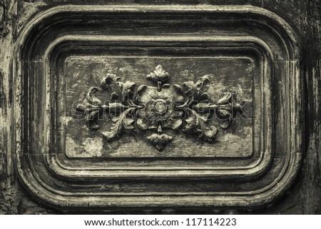 Very old looking wooden door ornament detail - stock photo