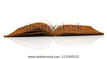 Very old open book isolated over white background