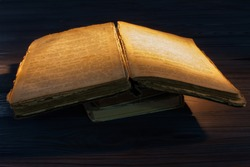 Very old opened book. Holy bible scripture text.