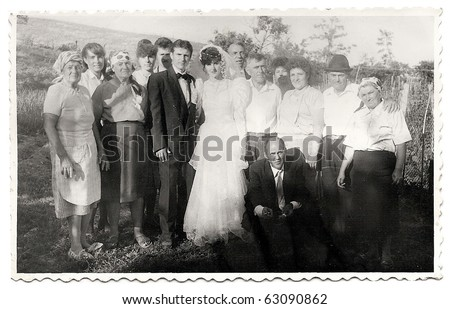 very old photo group, of a just married couple