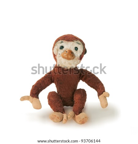 very old toy monkey isolated