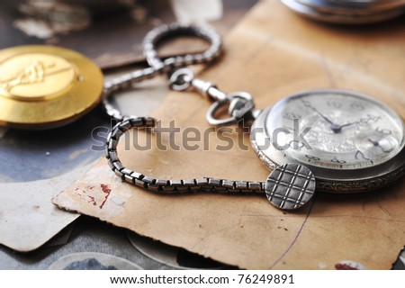 very old watch on the grunge post card and photo