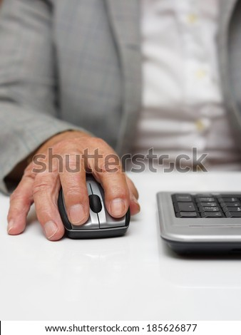 very old woman typing on computer mouse