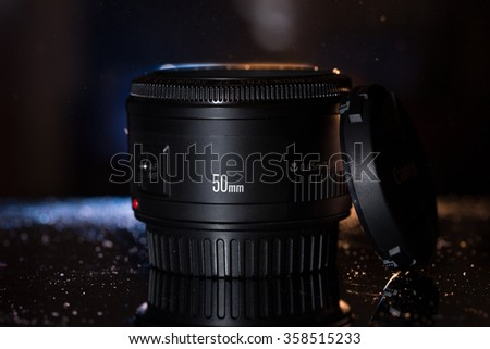 Very popular Canon EF 50mm f/1.8 II lens on black background #358515233