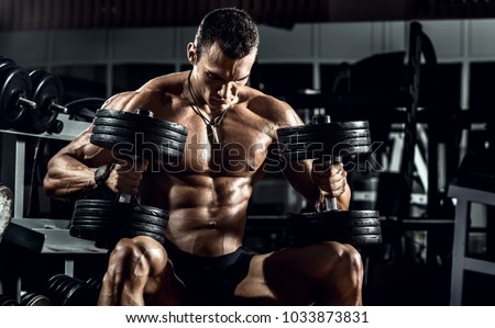 very power guy - bodybuilder, execute exercise with weight, inside gym, horizontal photo #1033873831