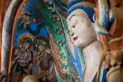 Very rare image from inside of Mogao Grottos cave 428. This image is of the main Buddha of the large central monument.