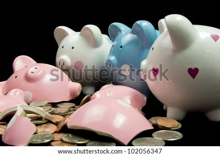 Very sad piggy banks looking at broken friend