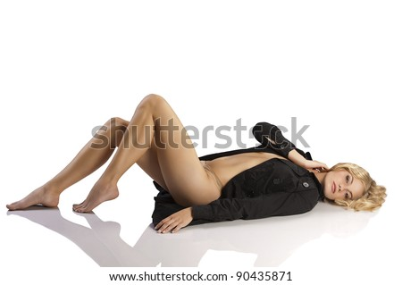 very sexy and young blond girl layng down on white wearing a black coat over her naked body