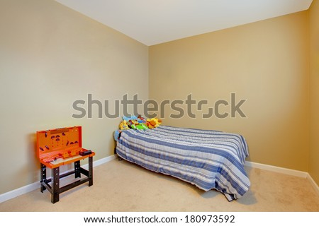Very simple boys empty bedroom with a single bed