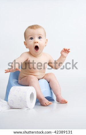 Very surprised little girl on potty with lavatory paper,on white background.