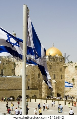 Very symbolic picture of Jerusalem. Israeli flags, the western wall, and the golden dome mosque