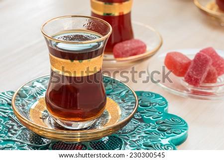 Very taste black Turkish tea drinking, traditional Turkish tea in glasses