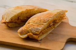 Very tasty big sandwich with meat stuffed and homemade crunchy and fluffy bread. It is a traditional portuguese pork beef sandwich
