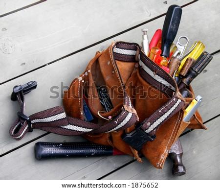 Very used tool belt on wood