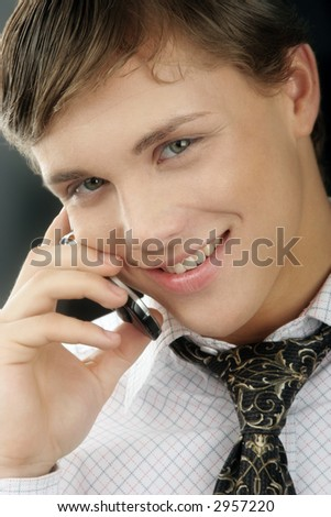 Very young and very attractive  businessman  with phone