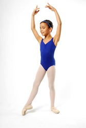 Very Young Ballerina Posing on White Background
