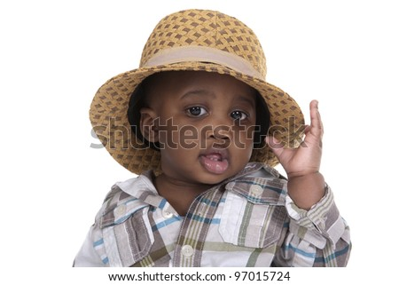 very young child with hat on white background