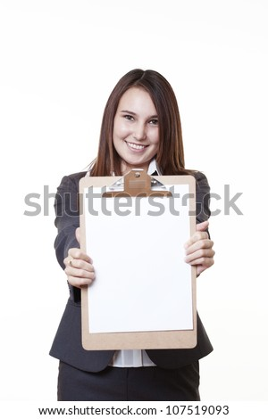 very young looking woman in a suit just starting out in business  holding up a clip board
