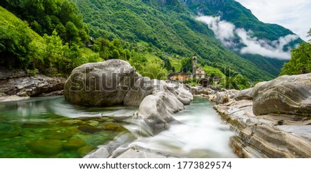 Photo of  Verzasca River at Lavertezzo - clear turquoise water with rocks in Ticino - Valle Verzasca - Valley in Tessin, Switzerland