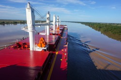 Vessel proceeding up the Parana River. Type of ship: Bulk carrier with cranes. Rio Parana, Argentina.