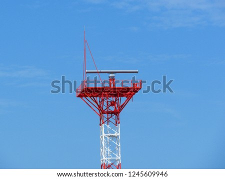 Vessel Traffic Services (VTS) and Coastal Surveillance tower at Gulf of Thailand Coast. Rotating coastal array radar scanner or Radar tower or radio lighthouse controlling marine traffic.