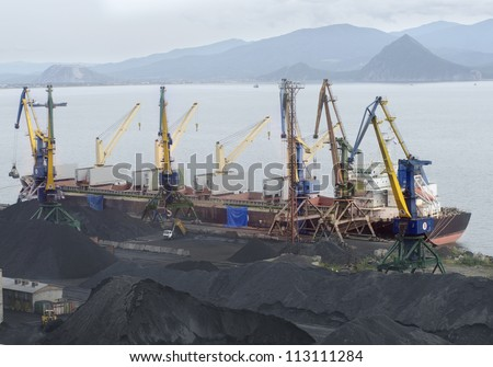 Vessel under loading in port  Russia - stock photo