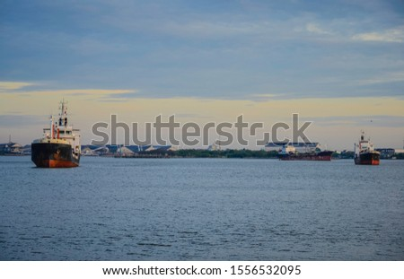 Vessels cruise along Bangpakong River in Thailand  #1556532095