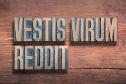 vestis virum reddit ancient Latin saying meaning - clothes make the man, combined on vintage varnished wooden surface
