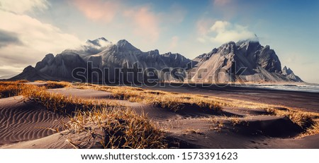 Photo of  Vestrahorn mountaine on Stokksnes cape in Iceland during sunset. Amazing Iceland nature seascape. popular tourist attraction. Best famouse travel locations. Scenic Image of Iceland