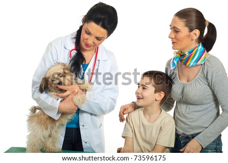 Vet doctor examine puppy dog and his family looking  at them isolated on white background