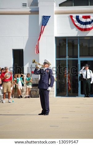 Veteran playing taps at Memorial Day ceremony