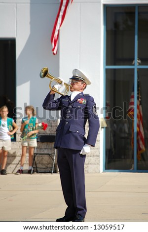 Veteran playing taps at Memorial Day ceremony people