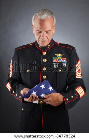 Veteran Soldier Marine holds a Flag