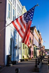 Veterans Day in Leadville Colorado and The American flag, stars and stripes, is flying in the wind