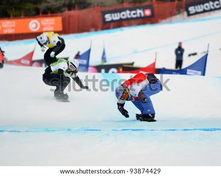 VEYSONNAZ, SWITZERLAND - JANUARY 19: L. Jacobellis (USA) beats A. Jekova (BUL) over the line in final of the FIS World Championship Snowboard Cross finals on January 19, 2012 in Veysonnaz Switzerland