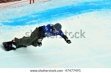 VEYSONNAZ, SWITZERLAND - JANUARY 15: Ladies finalist Faye Gulini of the USA competes in the FIS World Championship Snowboard Cross  Finals January 15, 2010 in Veysonnaz, Switzerland. #47477491