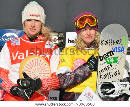 VEYSONNAZ, SWITZERLAND - JANUARY 22: Left silver for D Maltais (CAN) and gold for L Jacobellis (USA) at the FIS World Championship Snowboard Cross finals on January 22, 2012 in Veysonnaz, Switzerland
