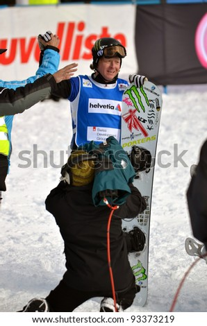 VEYSONNAZ, SWITZERLAND - JANUARY 22: World championn Nate Holland (USA) at the finish line of the FIS World Championship Snowboard Cross finals : January 22, 2012 in Veysonnaz Switzerland