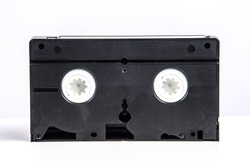 VHS video cassette isolated on white, retro video technology , analog magnetic tape