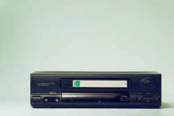 VHS video recorder Retro video recorder with video cassette on a light background