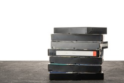 VHS videotape on a black table with isolated background