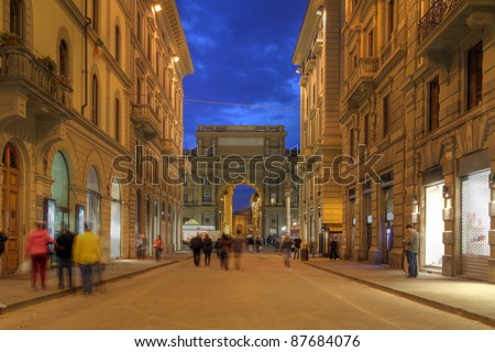 "Via degli Speziale leading towards the Republic Square (Piazza della Repubblica) and the Arch (""Arcone"") in Florence, Italy at night - stock photo"