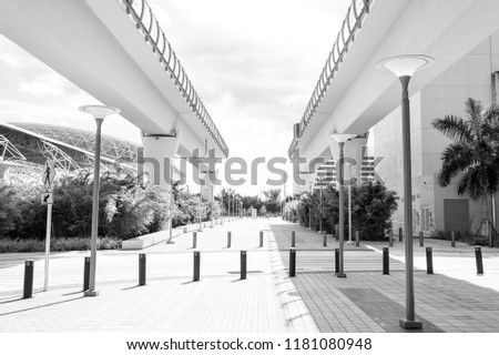 Viaduct structures in downtown district of miami, usa. Overpass or bridge railway road on sunny outdoor. Structure and construction design. Metrorail system and transportation. #1181080948