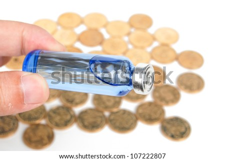 Vial and coin